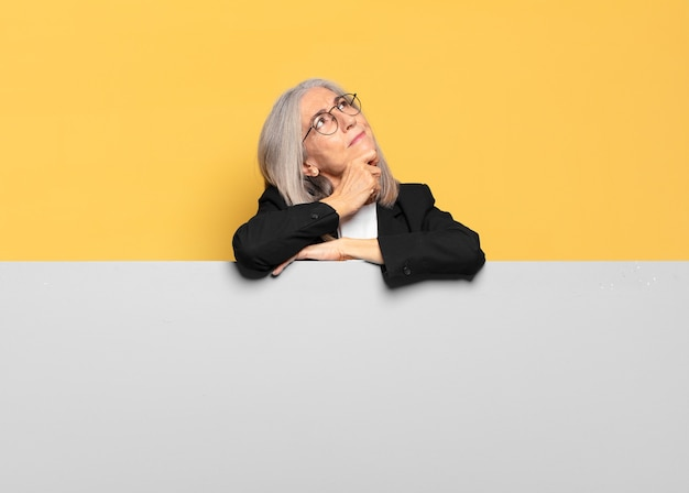 Pretty senior gray hair businesswoman with a copy space to place your concept