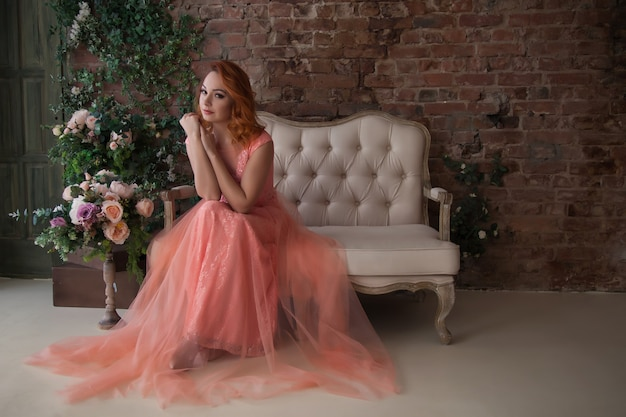 Pretty, slender woman with beautiful red hair