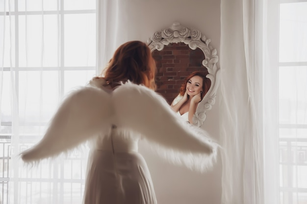 Pretty, slender woman with wings