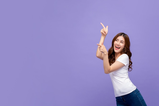 Pretty smiling asian woman pointing hand