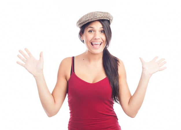 Pretty smiling and cheerful brunette woman with french cap and red tank top