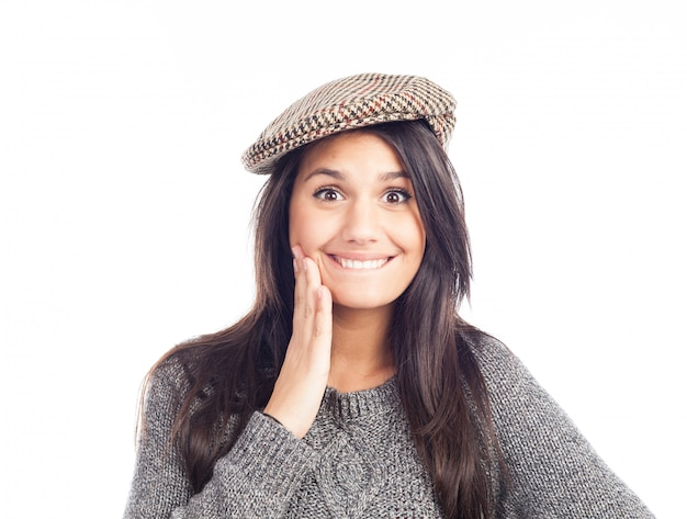 Pretty smiling and cheerful brunette woman with a french cap and a wool sweater