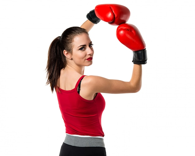 Pretty sport woman with boxing gloves