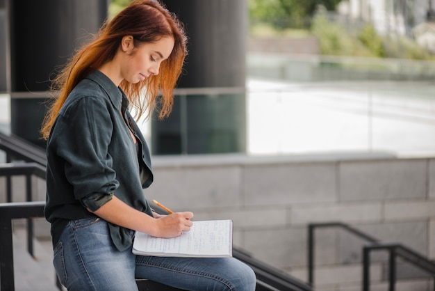 Pretty student with documents