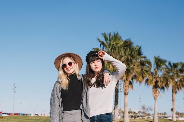 Pretty stylish girls posing on street