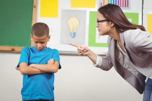 Pretty teacher reprimanding a pupil