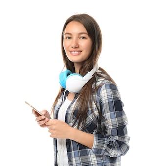 Pretty teenage girl posing on white surface