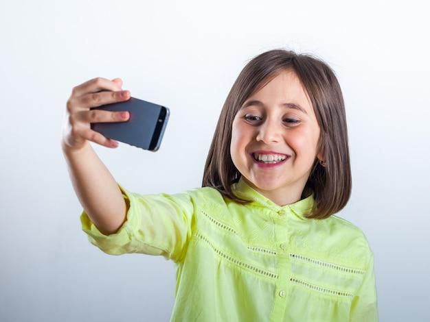 Pretty teenage girl with mobile phone