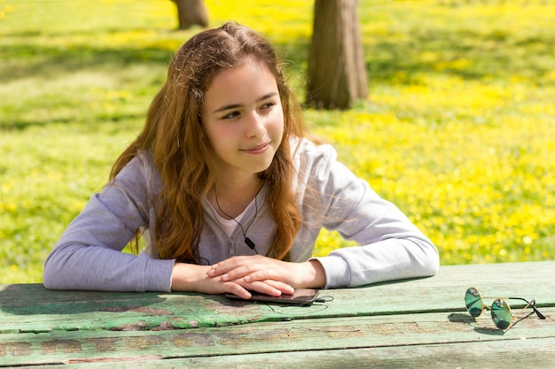 Pretty teenager girl at the summer park