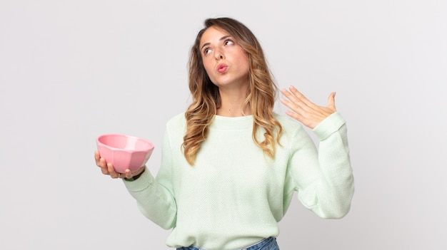 Pretty thin woman feeling stressed, anxious, tired and frustrated and holding an empty pot bowl