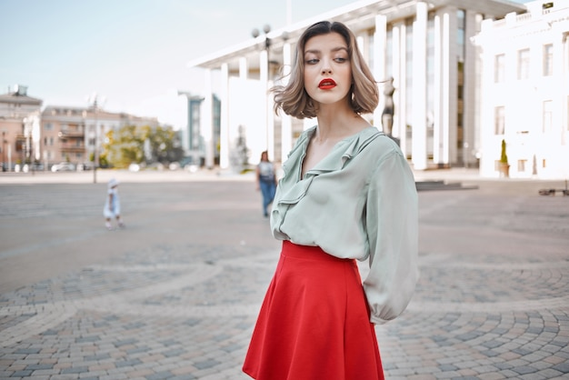 Pretty woman attractive look red lips walk in the park summer