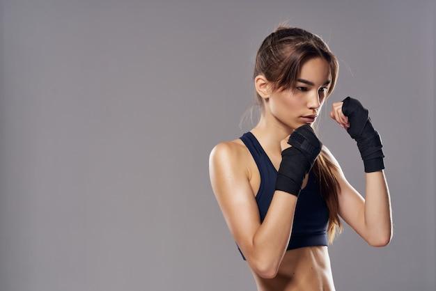 Pretty woman boxing workout exercises fitness posing studio lifestyle