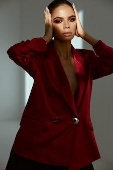 Pretty woman bright cosmetics decoration fashionable clothes closeup