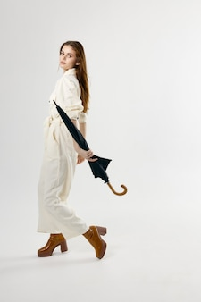Pretty woman brown shoes fashion umbrella in hands from rainy weather