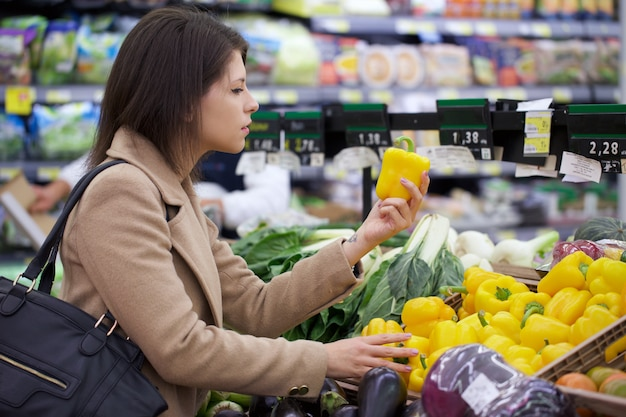 Pretty woman buy at supermarket
