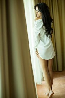 Pretty woman by the window