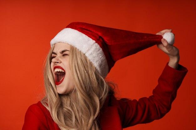 きれいな女性のクリスマス休暇新年の楽しみ。高品質の写真