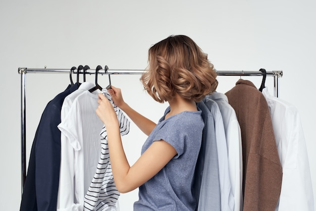Pretty woman clothes fitting modern style isolated background. high quality photo