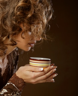 Pretty woman drinking coffee