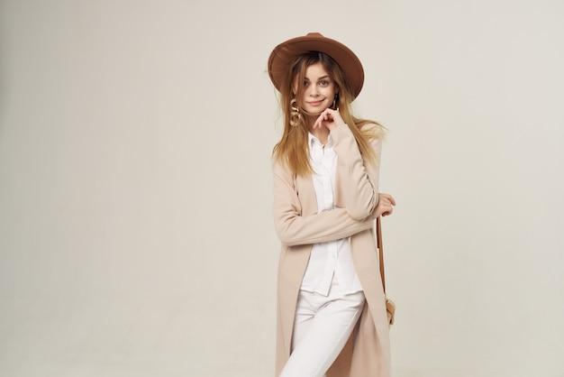 Pretty woman in fashionable hat posing