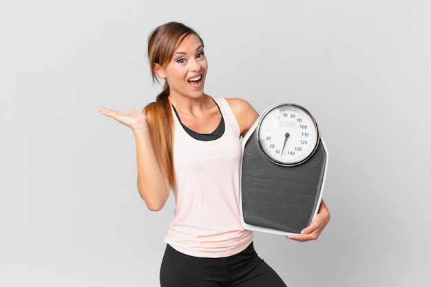 Pretty woman feeling happy and astonished at something unbelievable. diet concept