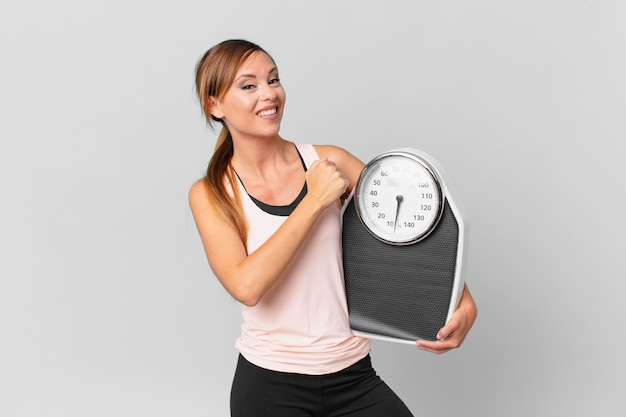 Pretty woman feeling happy and facing a challenge or celebrating. diet concept