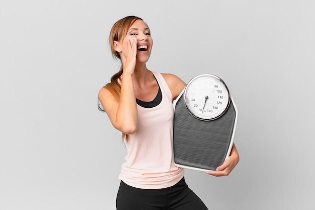 Pretty woman feeling happy,giving a big shout out with hands next to mouth. diet concept