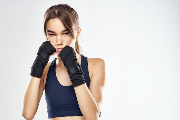 Pretty woman hand bandages punch workout fighter isolated background