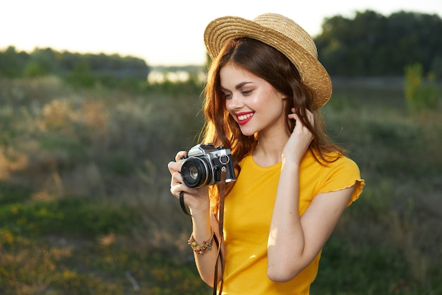 Pretty woman in hat photographer hobby lifestyle summer nature
