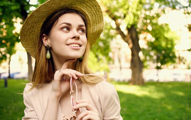 Pretty woman in hat and sunglasses outdoors