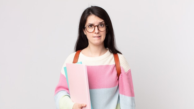 Pretty woman looking puzzled and confused. university student concept
