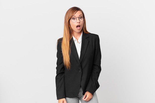 Pretty woman looking very shocked or surprised. business concept