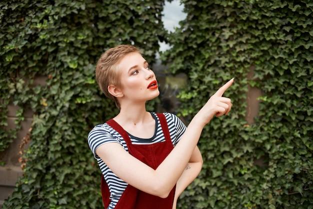 Pretty woman outdoors a cup of coffee fun walk
