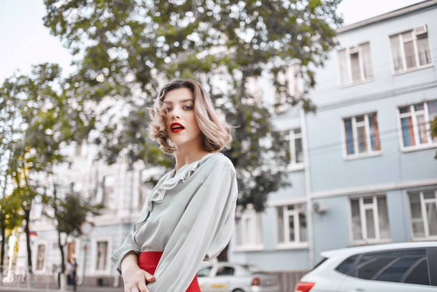 Pretty woman outdoors red lips walk lifestyle posing