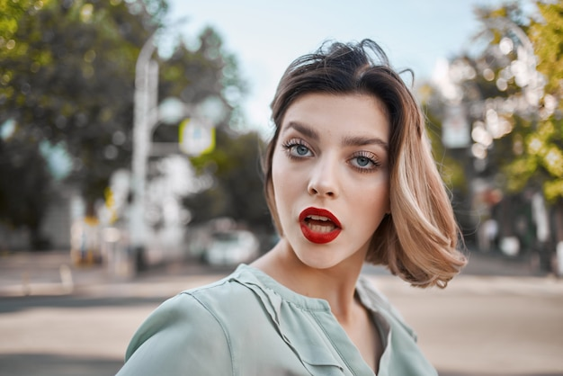 Pretty woman outdoors red lips walk outdoors lifestyle