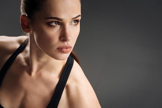 Pretty woman posing in sportswear