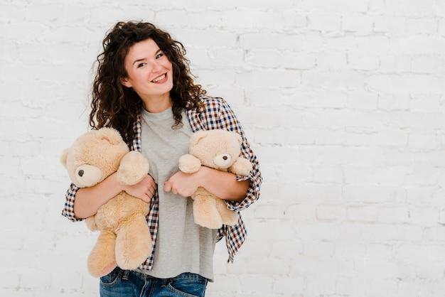 Pretty woman posing with plush toys