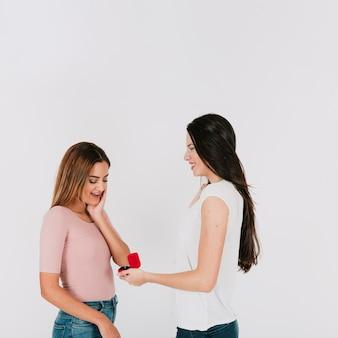 Pretty woman proposing to girlfriend