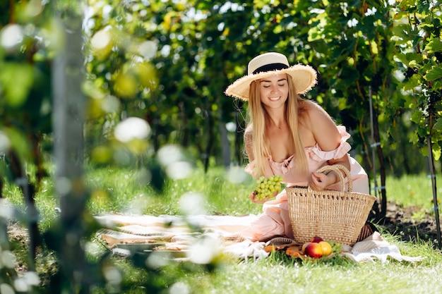 Pretty woman puts fruits on plaid.
