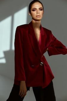Pretty woman in red blazer fashion attractive look studio luxury