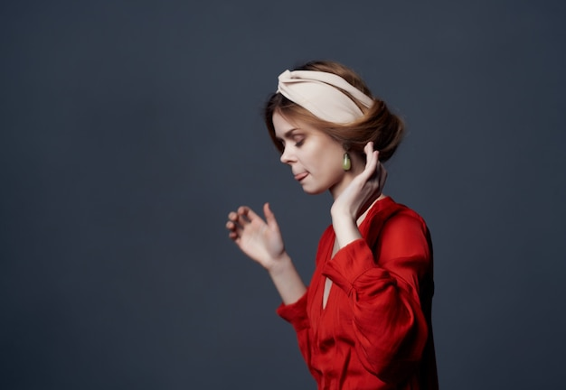 Pretty woman in red dress fashion modern style dark background