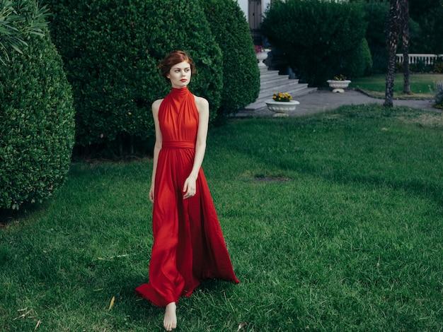 Pretty woman red dress walking luxury model outdoors