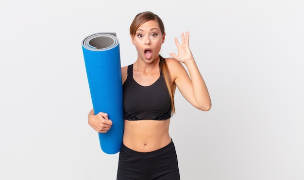 Pretty woman screaming with hands up in the air. yoga concept