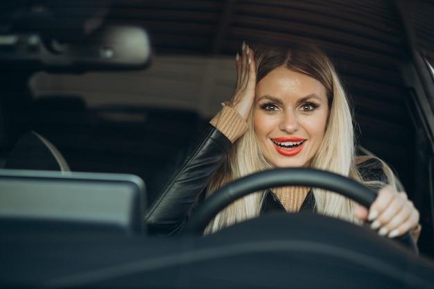Pretty woman sitting in her car