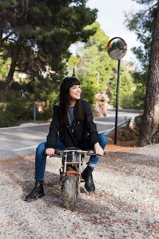 Pretty woman sitting on motorcycle
