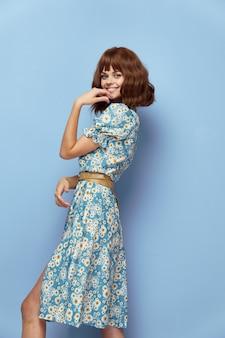 Pretty woman smile hand near face summer dress short hair