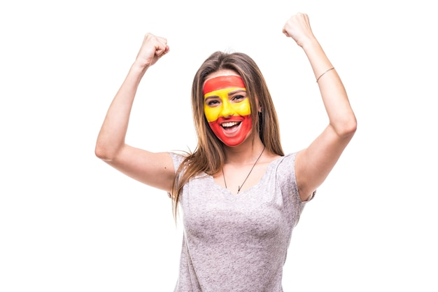 Pretty woman supporter fan of spain national team painted flag face get happy victory screaming into a camera. fans emotions.