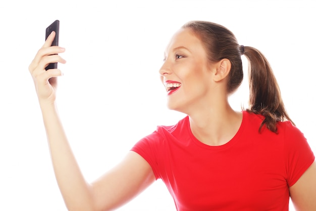 Pretty woman taking selfies