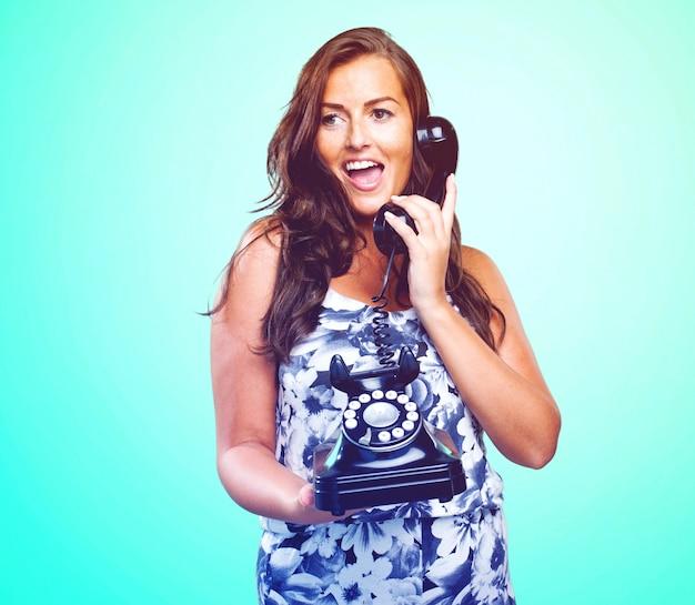 Pretty woman talking on telephone