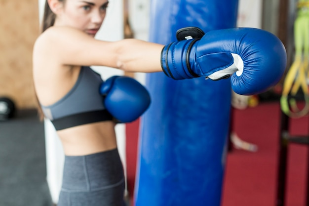 Pretty woman training to punch